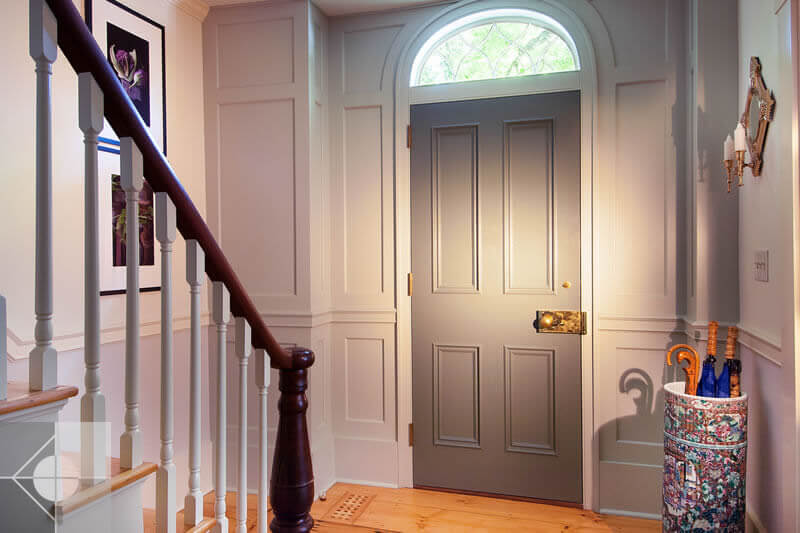 Entrance way of Greek Revival home by Phelps Architects.