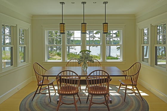 Dining room of Cushing, Maine home by Phelps Architects.