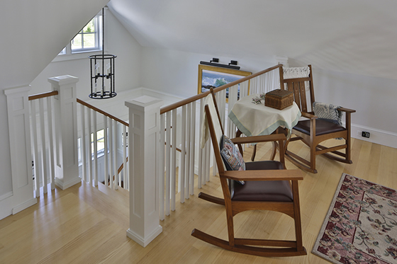 Interior design upstairs landing with rocking chairs in Cushing, Maine home by Phelps Architects.