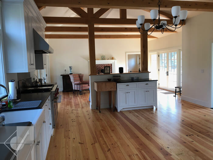 Farm-house style kitchen and great room in Newcastle, Maine by Phelps Architects.