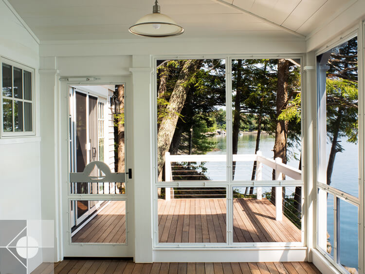 Screened in porch on cottage in Edgecomb, Maine by Phelps Architects