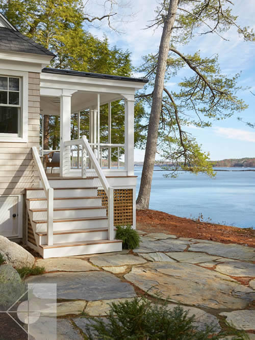 Exterior walkway and stairs to cottage in Edgecomb, Maine by Phelps Architects