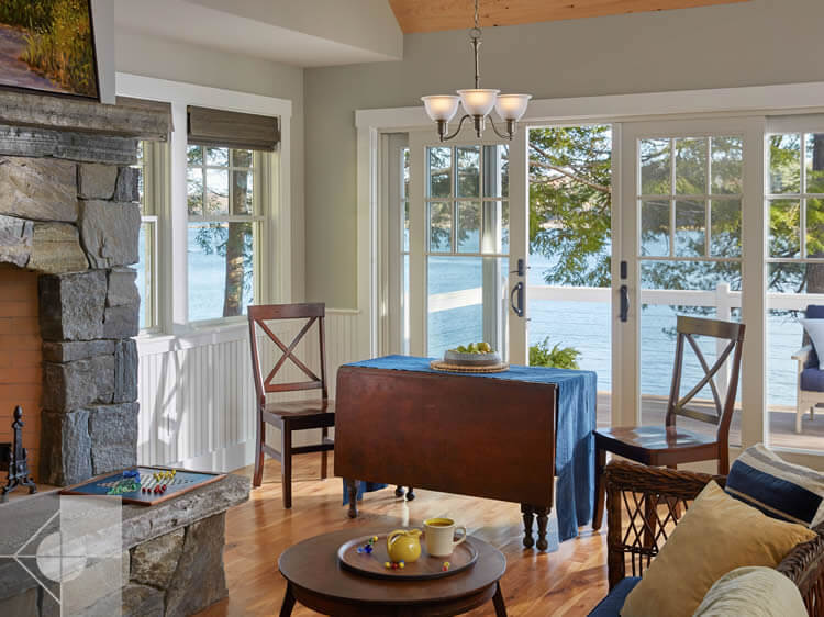 Dining area of cottage in Edgecomb, Maine by Phelps Architects