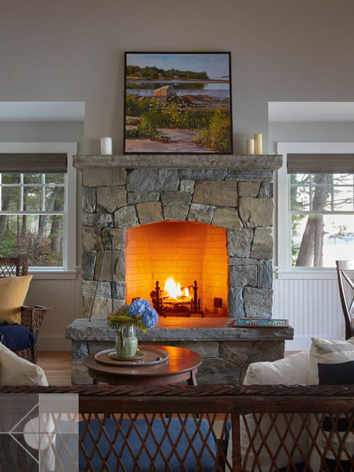Fireplace in cottage in Edgecomb, Maine by Phelps Architects