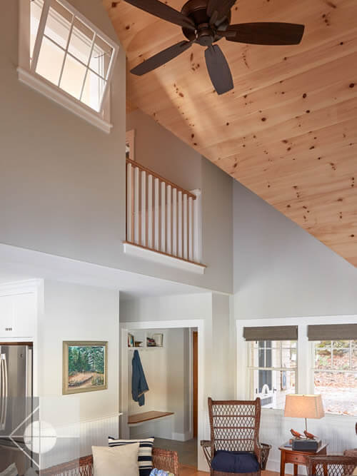 Secong floor view of living room in Edgecomb, Maine home by Phelps Architects