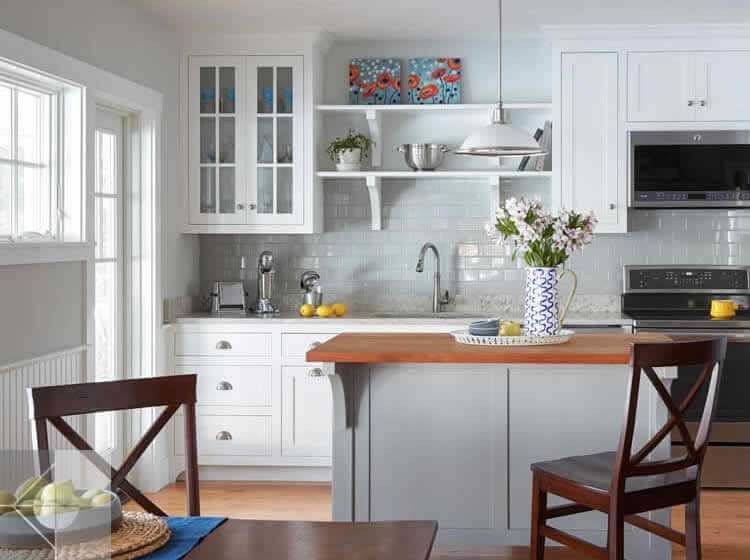 Kitchen in cottage in Edgecomb, Maine by Phelps Architects