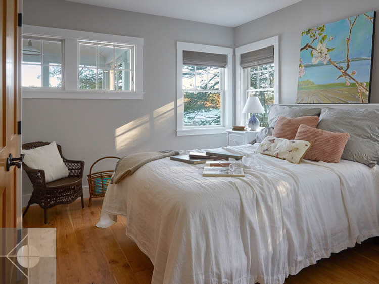 Bedroom in cottage in Edgecomb, Maine by Phelps Architects