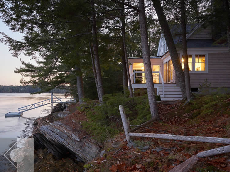 Evening view of cottage in Edgecomb, Maine by Phelps Architects